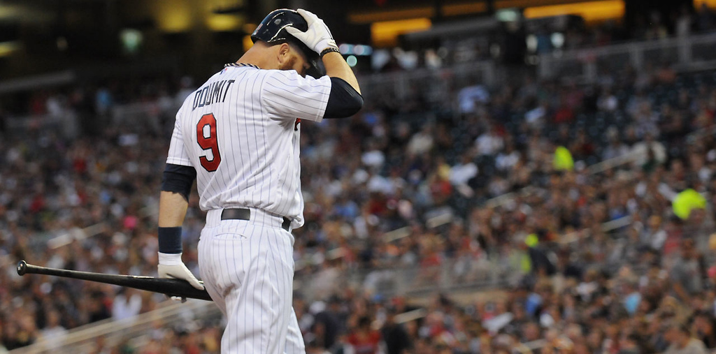 . Ryan Doumit (9) holds his head after striking out against the White Sox with the bases loaded on Friday,  Aug. 16, 2013, at Target Field. The Twins lost 5-2. (Pioneer Press: John Autey)