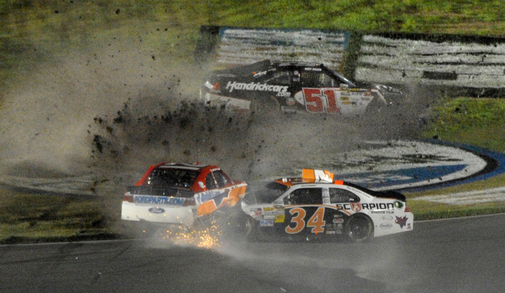 Description of . David Ragan (34), Trevor Bayne, left, and Kurt Busch (51) are involved in a wreck during the NASCAR Daytona 500 auto race at Daytona International Speedway in Daytona Beach, Fla., Monday, Feb. 27, 2012. (AP Photo/Phelan M. Ebenhack)