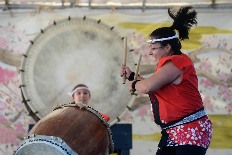 . Keiko Ozaki, right, drummer in the Mirai Daiko Colorado Japanese Drum Ensemble performs with the group during the annual Cherry Blossom Festival at the Sakura Square Saturday afternoon, June 28, 2014. The festival, which runs through Sunday 11-4 pm, showcases the Japanese American Culture that includes traditional dances, music, various demonstrations, and food.(Photo By Andy Cross / The Denver Post)