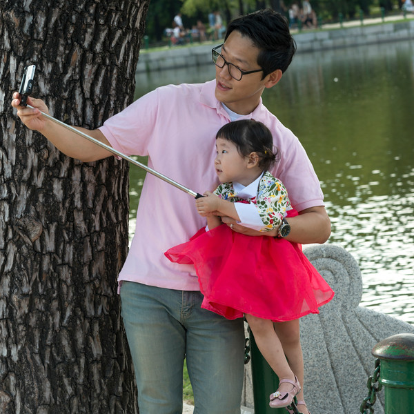 Father taking selfie with his daughter, Seoul, South Korea
