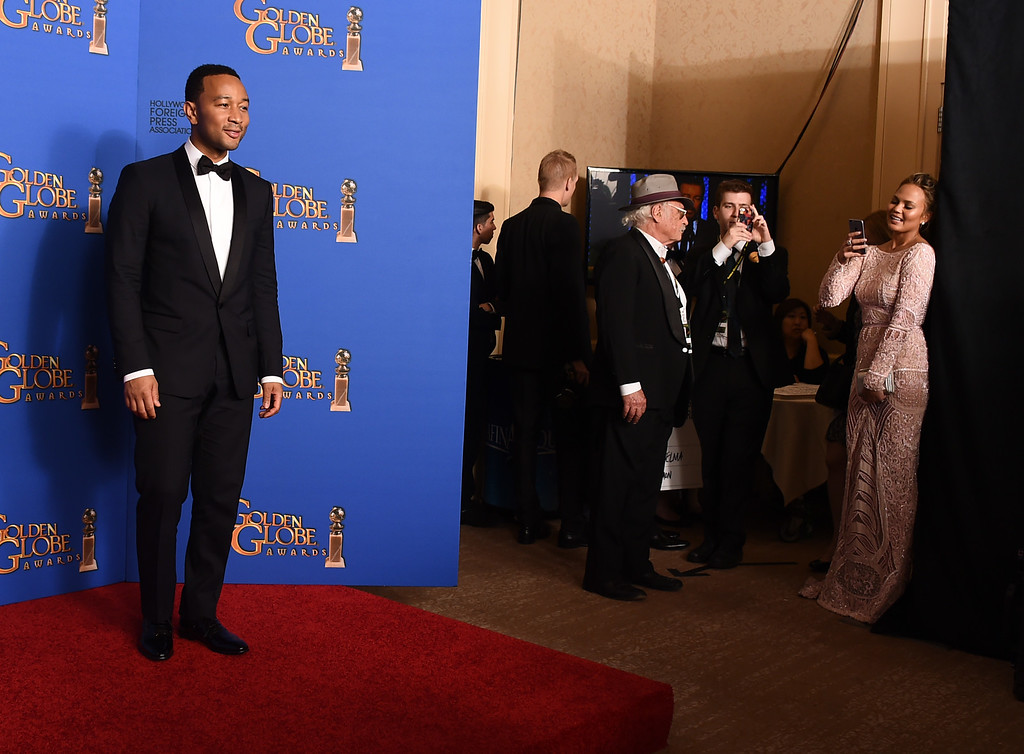 . John Legend poses in the press room after winning the award for best original song ìGloryî in a film for ìSelmaî at the 72nd annual Golden Globe Awards at the Beverly Hilton Hotel on Sunday, Jan. 11, 2015, in Beverly Hills, Calif. (Photo by Jordan Strauss/Invision/AP)