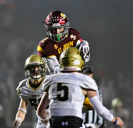12/14/2019 Mike Orazzi | Staff St. Joseph High School's Brady Hutchison (1) hauls in a pass during a 17-13 win over Daniel Hand at Veteran's Stadium in New Britain on Saturday.
