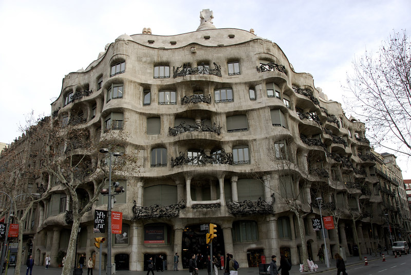 """La Pedrera by Antoni Gaudi  Built in 1905 can be found at No 92 Passeig de Gràcia at the junction with Carrer Provenca. The Pedrera which means """"Quarry"""" because of its stone like appearance, was originally called Casa Milà.   La Pedrera was constructed to house apartments and offices however the owner had difficulty renting the apartments because prospective tenants thought they would have problems furnishing the rooms as they were irregularly shaped."""