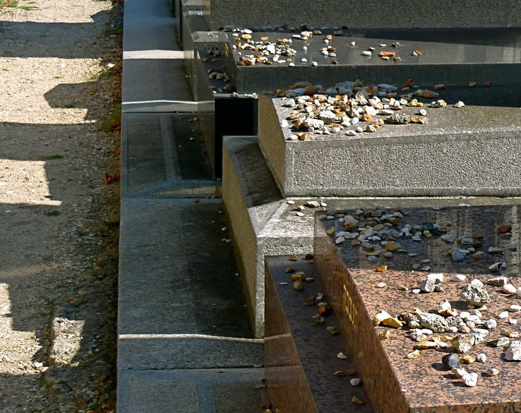 Following Jewish custom, small stones are placed upon these graves in Montparnasse Cemetery in Paris.