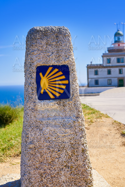 Saint James Way sign and lighthouse of Finisterre