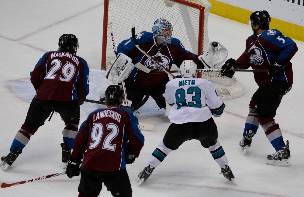. Colorado Avalanche goalie, Semyon Varlamov, grabs a lose puck in front of the net against the San Jose Sharks Saturday afternoon, March 29, 2014. Varlamov had 47 saves in the game. (Photo By Andy Cross / The Denver Post)
