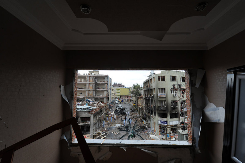 . Picture taken from the window of a damaged building shows officers working on May 12, 2013 on a street damaged by a car bomb explosion which went off on May 11 in Reyhanli in Hatay, just a few kilometers from the main border crossing into Syria. Turkey was reeling from twin car bomb attacks which left at least 43 people dead in a town near the Syrian border, with Ankara blaming pro-Damascus groups and vowing to bring the perpetrators to justice.  BULENT KILIC/AFP/Getty Images