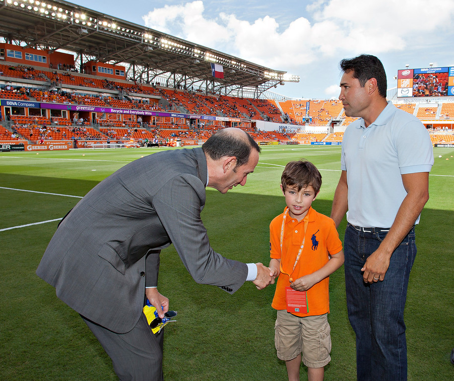 . HOUSTON - MAY 12:  MLS Commissioner Don Garber shakes hands with Oscar De La Hoya Jr. and Oscar De La Hoya  at BBVA Compass Stadium on May 12, 2012 in Houston, Texas. Houston defeated D.C. United 1-0. (Photo by Bob Levey/Getty Images)