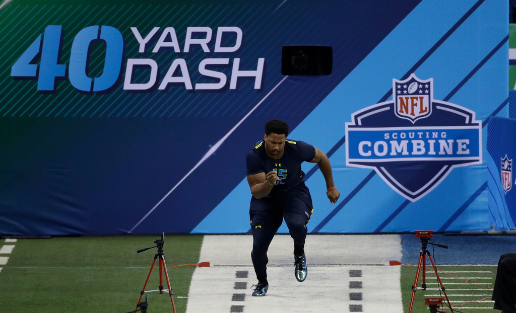 . Texas A&M defensive end Myles Garrett runs the 40-yard dash at the NFL football scouting combine Sunday, March 5, 2017, in Indianapolis. (AP Photo/David J. Phillip)