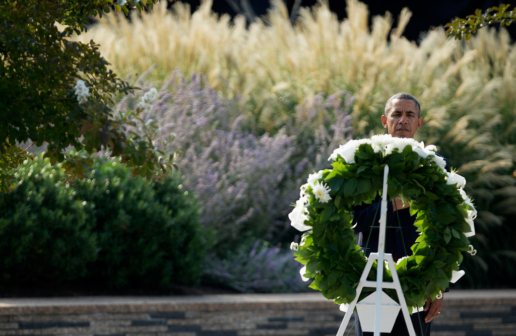 . President Barack Obama lays a wreath at the Pentagon, Wednesday, Sept. 11, 2013, during a ceremony marking the 12th anniversary of the worst terror attack on the US. The Pentagon was struck by one of the hijacked plane.  (AP Photo/Manuel Balce Ceneta)