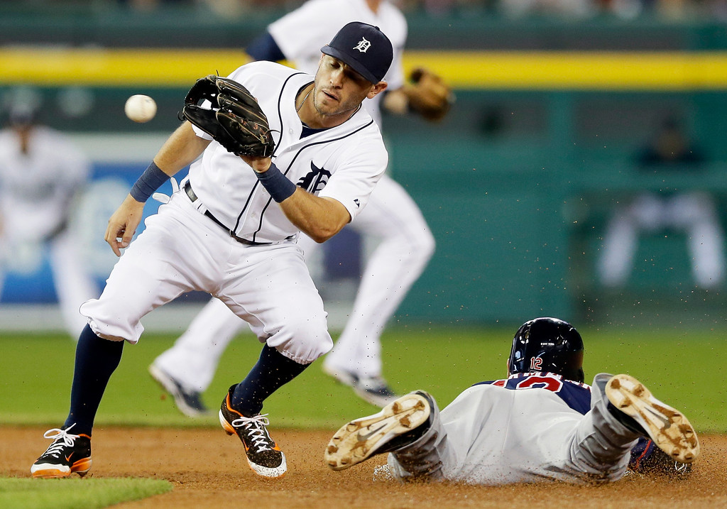 . Minnesota Twins\' Chris Herrmann beats the throw to Detroit Tigers second baseman Ian Kinsler, left, and steals second during the third inning of a baseball game in Detroit, Saturday, Sept. 27, 2014. (AP Photo/Carlos Osorio)