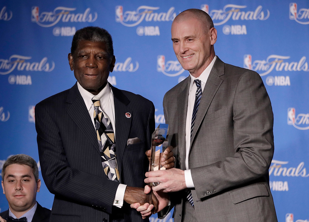. Former Golden State Warriors head coach Al Attles, left, accepts the NBA Coaches Association\'s Chuck Daly Lifetime Achievement Award from Dallas Mavericks head coach Rick Carlisle before Game 2 of basketball\'s NBA Finals between the Warriors and the Cleveland Cavaliers in Oakland, Calif., Sunday, June 4, 2017. (AP Photo/Marcio Jose Sanchez)