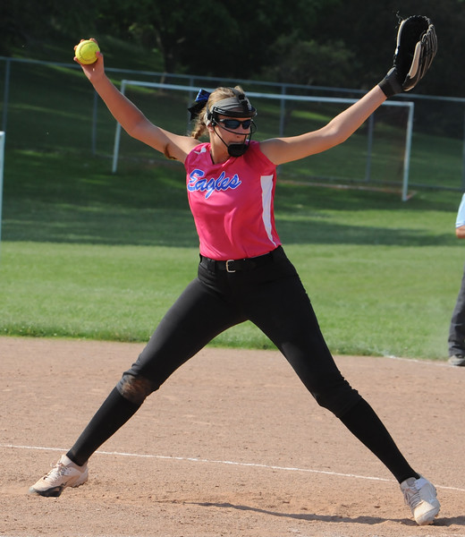 Kiersten Korber of Utica Eisenhower delivers a pitch during the MHSAA D1 softball pre-district game against Rochester played on Tuesday May 29, 2018 at Rochester High School. Korber earned the complete game shut out as the Eagles defeated the Falcons 9-0. (Digital First Media Photo by Ken Swart)