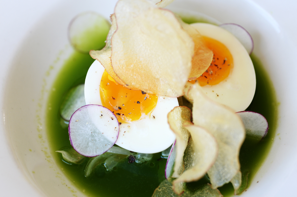. Soft Hen Egg - Spring pea brodo, Charred Snap peas, Onion sautées, potato chips. BISTRO BARB�S in Park Hill. Denver, Colorado. June 25. 2014. (Photo by Hyoung Chang/The Denver Post)