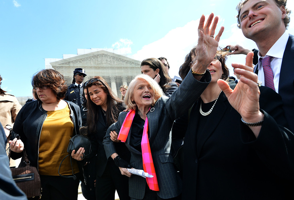. Plaintiff of the US v. Windsor case challenging the constitutionality of Section 3 of the Defense of Marriage Act (DOMA), 83-year-old lesbian widow Edie Windsor (C), greets same-sex marriage supporters as she leaves the Supreme Court on March 27, 2013 in Washington, DC. The US Supreme Court tackled same-sex unions for a second day Wednesday, hearing arguments for and against the 1996 US law defining marriage as between one man and one woman. After the nine justices mulled arguments on a California law outlawing gay marriage on Tuesday, they took up a challenge to the constitutionality of the federal Defense of Marriage Act (DOMA). The 1996 law prevents couples who have tied the knot in nine states -- where same-sex marriage is legal -- from enjoying the same federal rights as heterosexual couples. JEWEL SAMAD/AFP/Getty Images