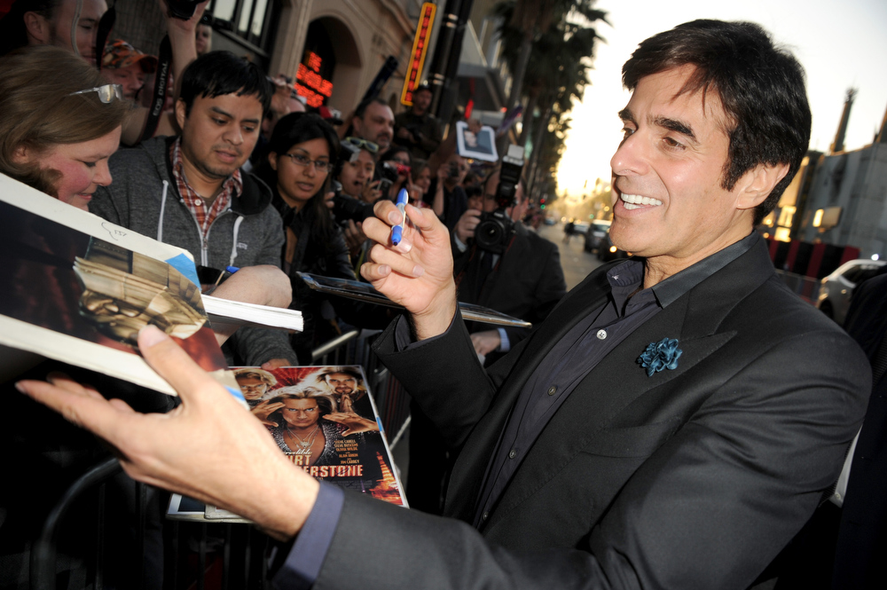 ". Illusionist David Copperfield attends the premiere of Warner Bros. Pictures\' ""The Incredible Burt Wonderstone\"" at TCL Chinese Theatre on March 11, 2013 in Hollywood, California.  (Photo by Kevin Winter/Getty Images)"