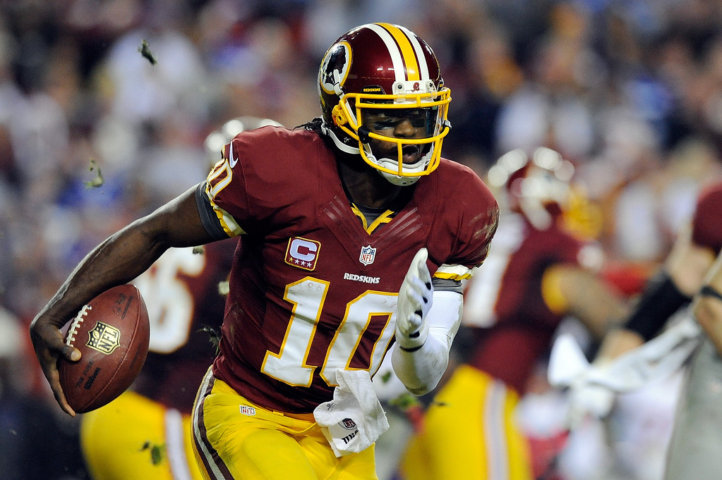 . LANDOVER, MD - DECEMBER 03:  Robert Griffin III #10 of the Washington Redskins scrambles with the ball in the second half against the New York Giants at FedExField on December 3, 2012 in Landover, Maryland.  (Photo by Patrick McDermott/Getty Images)
