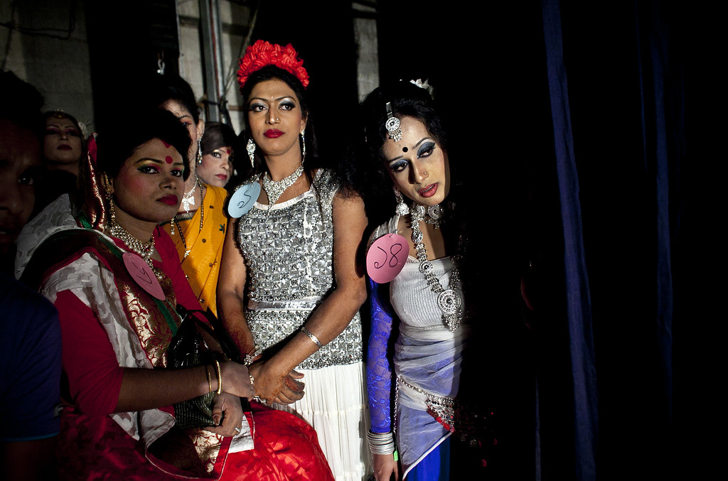 . Hijras, or transgenders, watch a performance backstage at the Hijra talent show, part of the first ever event called Hijra Pride 2014, on November 10, 2014 in Dhaka, Bangladesh.  In 2013 Bangladesh officially recognized Hijras as a third gender, though homosexuality still remains illegal. Despite these strides Hijras continue to face violence and harassment as part of their daily life in Bangladesh. (Photo by Allison Joyce/Getty Images)