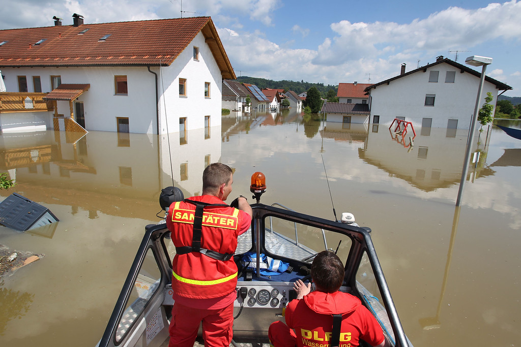 . Members of the German Life Saving Association DLRG, patrol onboard a boat through the flooded streets in Deggendorf, Bavaria, 5 June 2013, after the Danube river broke its banks.  AFP PHOTO / KARL-JOSEF HILDENBRAND /AFP/Getty Images