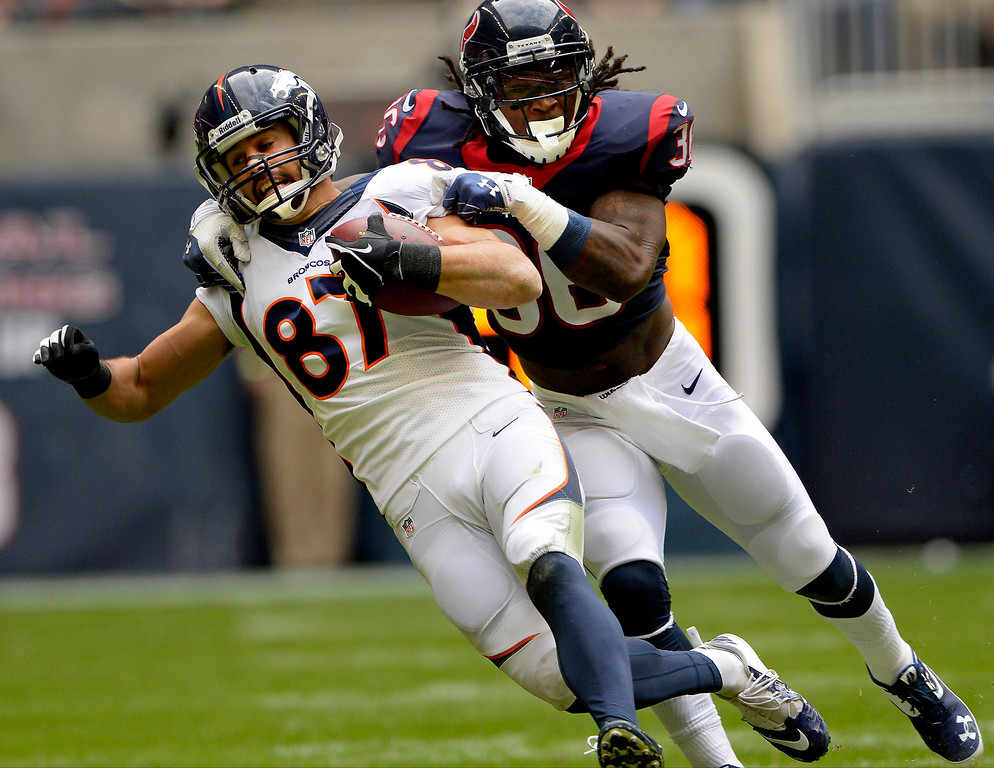 . Wide receiver Eric Decker #87 of the Denver Broncos picks up a first down in front of strong safety D.J. Swearinger #36 of the Houston Texans in the first quarter at Reliant Stadium December 22, 2013 Houston, Texas. (Photo By Joe Amon/The Denver Post)