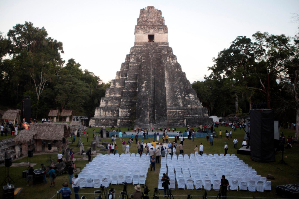 Description of . A general view of the Grand Jaguar pyramid a day before the Oxlajuj Baktun celebration at the Tikal Mayan ruins in Peten, Guatemala, December 20, 2012. This week, at sunrise on Friday, December 21, an era closes in the Maya Long Count calendar, an event that has been likened by different groups to the end of days, the start of a new, more spiritual age or a good reason to hang out at old Maya temples across Mexico and Central America. REUTERS/William Gularte