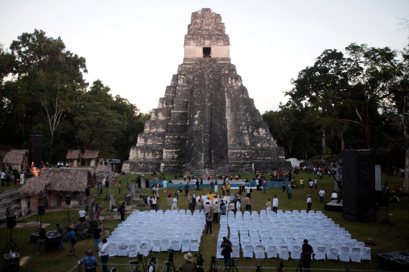 . A general view of the Grand Jaguar pyramid a day before the Oxlajuj Baktun celebration at the Tikal Mayan ruins in Peten, Guatemala, December 20, 2012. This week, at sunrise on Friday, December 21, an era closes in the Maya Long Count calendar, an event that has been likened by different groups to the end of days, the start of a new, more spiritual age or a good reason to hang out at old Maya temples across Mexico and Central America. REUTERS/William Gularte