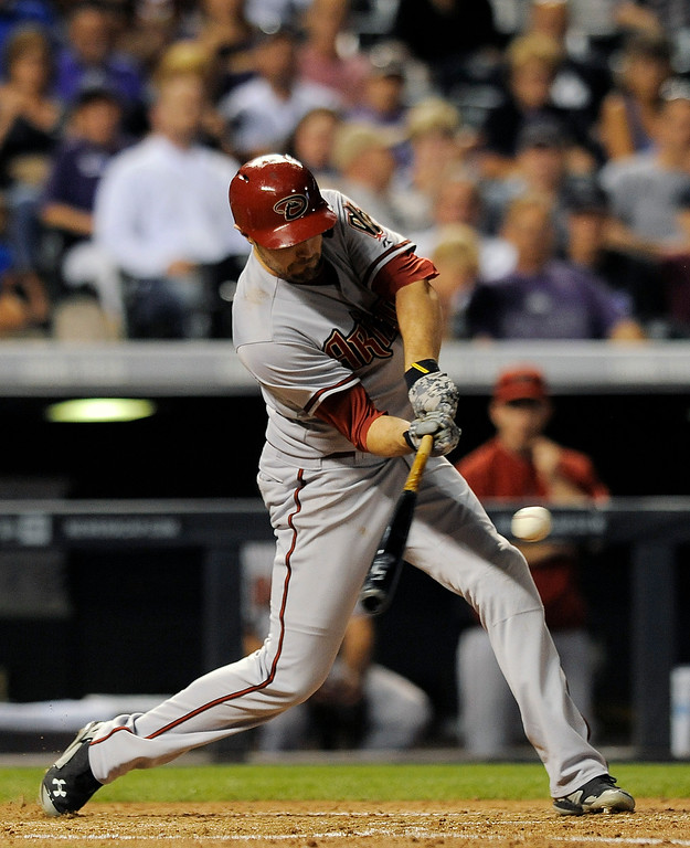 . Arizona Diamondbacks\' A.J. Pollock hits a single in the sixth inning of a baseball game against the Colorado Rockies, Thursday, Sept. 18, 2014, in Denver. (AP Photo/Chris Schneider)