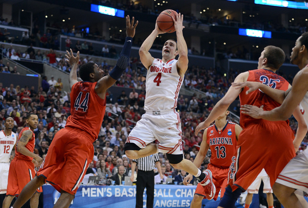 . Aaron Craft #4 of the Ohio State Buckeyes goes up for a shot against Solomon Hill #44 of the Arizona Wildcats in the second half during the West Regional of the 2013 NCAA Men\'s Basketball Tournament at Staples Center on March 28, 2013 in Los Angeles, California.  (Photo by Harry How/Getty Images)