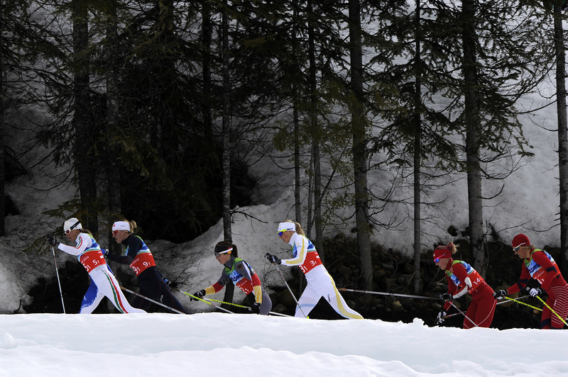 . (L-R) Italy\'s Arianna Follis, France\'s Aurore Cuinet, Germany\'s Katrin Zeller, Sweden\'s Anna Olsson, Kikkan Randall of the US and Norway\'s Vibeke W Skofterud compete in the women\'s Cross Country Skiing 4x5 km relay at Whistler Olympic Park during the Vancouver Winter Olympics on February 25, 2010. (JAVIER SORIANO/AFP/Getty Images)