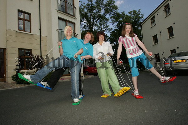 Kerry Scott and Mary Hull from Surestart with Wendy McKeown of the Feile committee and Megan Maguire on the Caterpillar Crawler. 07W30N24