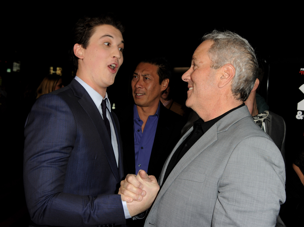 ". Actor Miles Teller (L) and producer David Hoberman arrive at the premiere of Relativity Media\'s ""21 And Over\"" at the Village Theatre on February 21, 2013 in Los Angeles, California.  (Photo by Kevin Winter/Getty Images)"
