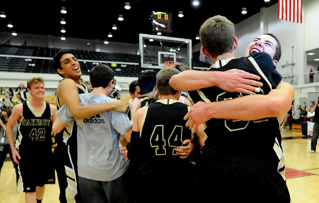. Oak Park celebrates after defeating St. Francis 60-53 during a CIF-SS Division 3A Championship basketball game at the Felix Event Center on the campus of Azusa Pacific University in Azusa, Calif., on Friday, March 7, 2014.  (Keith Birmingham Pasadena Star-News)