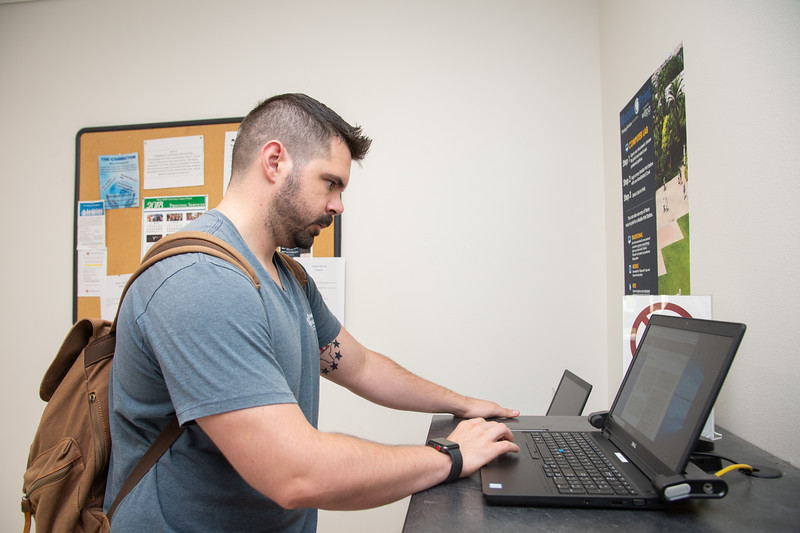 Liam MacCready using the printing services located inside the University Center.