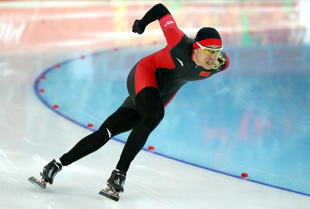 . Guojun Tian of China competes in the Speed Skating Men\'s 1000m during day five of the Sochi 2014 Winter Olympics at Adler Arena Skating Center on February 12, 2014 in Sochi, Russia.  (Photo by Robert Cianflone/Getty Images)