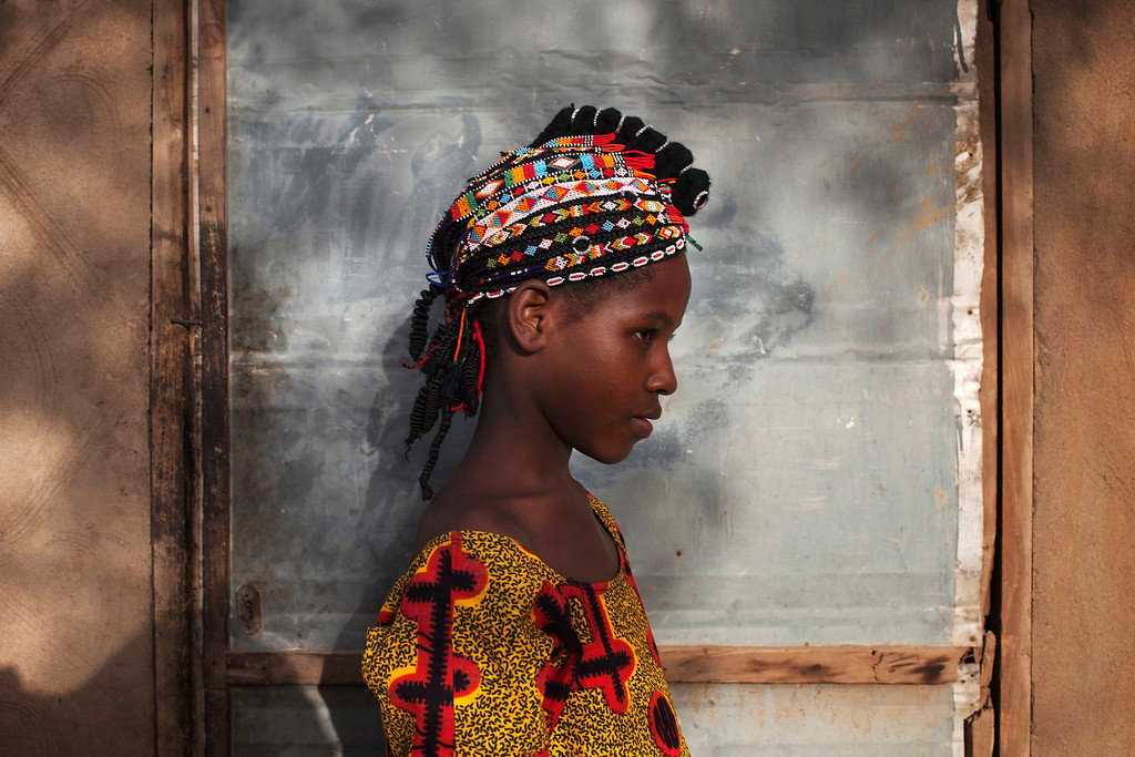 . Safiatou Maiga, 8, wears a traditional Songhai headdress made by artisan Hally Bara in Gao, Mali, March 6, 2013. Radical Islamist group MUJAO placed limitations on the wearing of traditional women\'s headdresses during their nine-month reign in Gao, which ended in January with the arrival of French and Malian troops. The headdresses, made of beads, gemstones, fabric and fake hair and traditionally worn by elites for special occasions, were criticised by MUJAO who said they were not Islamic enough. Issues surrounding the treatment of women are receiving special attention on March 8, which marks International Womenís Day. Picture taken March 6, 2013. REUTERS/Joe Penney
