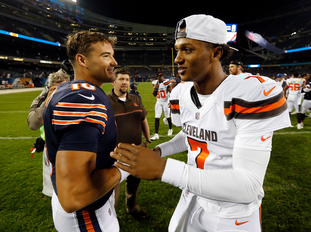 . Chicago Bears quarterback Mitchell Trubisky (10) and Cleveland Browns quarterback DeShone Kizer (7) greet each other after an NFL preseason football game, Thursday, Aug. 31, 2017, in Chicago. The Browns won 25-0. (AP Photo/Charles Rex Arbogast)