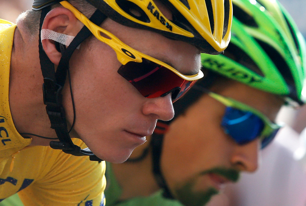. Christopher Froome of Britain, wearing the overall leader\'s yellow jersey, and Peter Sagan of Slovakia, wearing the best sprinter\'s green jersey, and sporting a green goatee, ride during the start of the 21st and last stage of the 100th edition of the Tour de France cycling race over 133.5 kilometers (83.4 miles) with start in Versailles and finish in Paris, France, Sunday July 21 2013. (AP Photo/Laurent Cipriani)