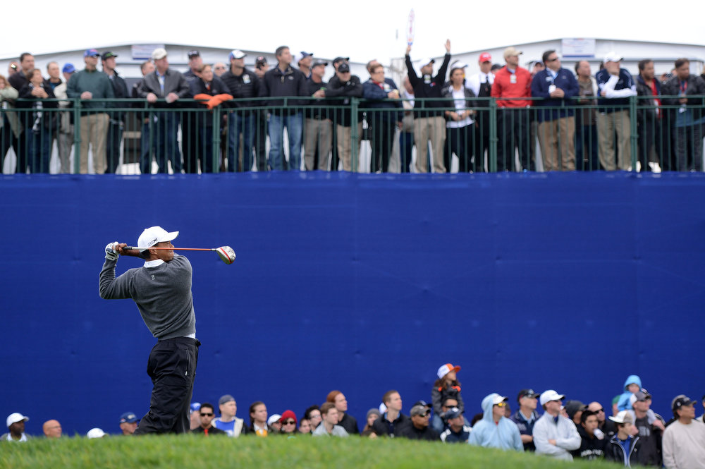 Description of . Tiger Woods tees off the 7th hole during the Third Round at the Farmers Insurance Open at Torrey Pines South Golf Course on January 27, 2013 in La Jolla, California. (Photo by Donald Miralle/Getty Images)