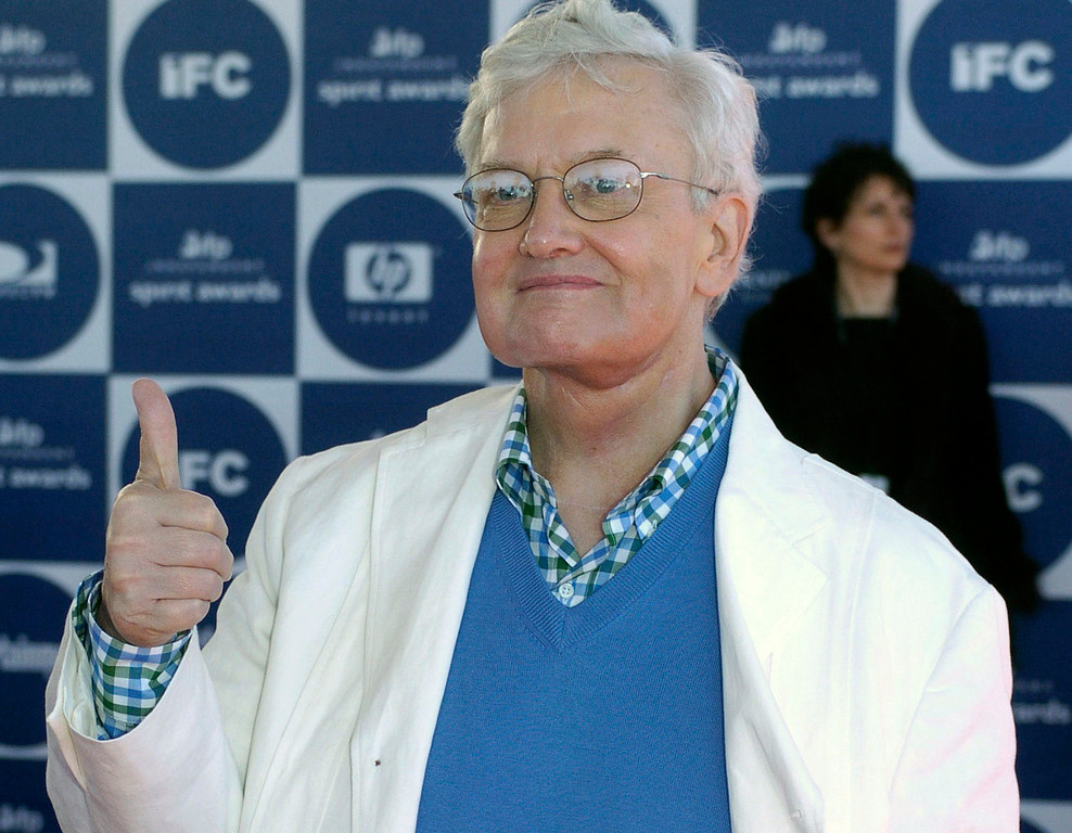 """. Film critic Roger Ebert gives thumbs up as he arrives for the 2004 IFP Independent Spirit Awards in Santa Monica, Calif., in a Saturday, Feb. 28, 2004 file photo. Roger Ebert has turned thumbs down on thumbs on \""""At the Movies with Ebert & Roeper.\""""(AP Photo/Chris Pizzello, file)"""