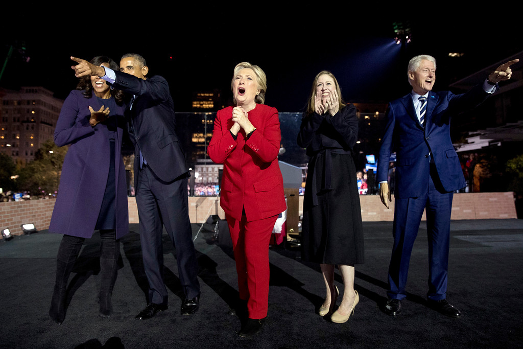 . Democratic presidential candidate Hillary Clinton, center, is joined on stage by first lady Michelle Obama, left, President Barack Obama, second from left, Chelsea Clinton, second from right, and former President Bill Clinton, right, after speaking at a rally at Independence Mall in Philadelphia, Monday, Nov. 7, 2016. (AP Photo/Andrew Harnik)