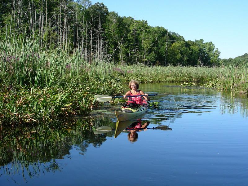 Karen Aupperlee paddling Perception Shadow in wetlands between Big Wabasis and Little Wabasis Lakes.