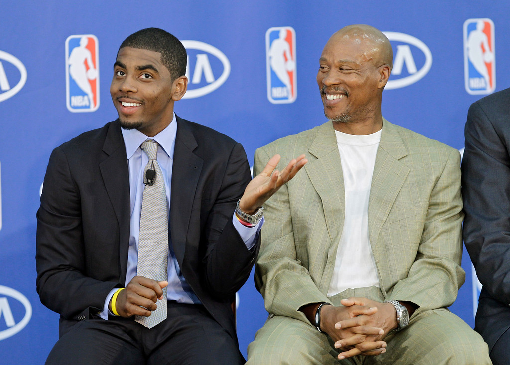 . Cleveland Cavaliers\' Kyrie Irving, left, jokes with head coach Byron Scott before Irving was presented with the NBA Rookie of the Year award at the basketball team\'s headquarters in Independence, Ohio Tuesday, May 15, 2012. (AP Photo/Mark Duncan)
