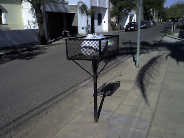 Argentina, San Nicolás. Elevated garbage bin.