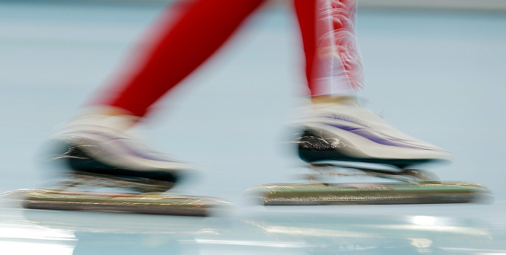 . A skater warms up for the women\'s 3000-meter speedskating competition at the 2014 Winter Olympics, Sunday, Feb. 9, 2014, in Sochi, Russia. (AP Photo/Morry Gash)