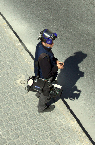 Cameraman with a gas mask.