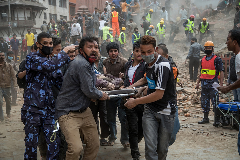 . Emergency rescue workers carry a victim on a stretcher after Dharara tower collapsed on April 25, 2015 in Kathmandu, Nepal. More than 100 people have died as tremors hit Nepal after an earthquake measuring 7.9 on the Richter scale caused buildings to collapse and avalanches to be triggered in the Himalayas. Authorities have warned that the death toll is likely to be much higher. (Photo by Omar Havana/Getty Images)