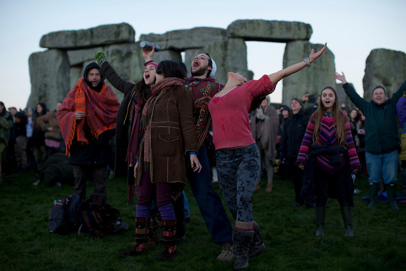 ". People react as they see the sun starting to rise on the horizon before its light hits them by the ancient stone circle of Stonehenge, in southern England, as access to the site is given to druids, New Age followers and members of the public on the annual Winter Solstice, Friday, Dec. 21, 2012.  Doomsday hour is here and so still are we.  According to legend, the ancient Mayans\' long-count calendar ends at midnight Thursday, ushering in the end of the world. Didn\'t happen.  ""This is not the end of the world. This is the beginning of the new world,\"" Star Johnsen-Moser, an American seer, said at a gathering of hundreds of spiritualists at a convention center in the Yucatan city of Merida, an hour and a half from the Mayan ruins at Chichen Itza.  (AP Photo/Matt Dunham)"