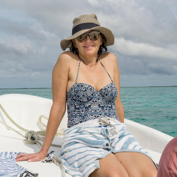 Woman on boat, Turneffe Atoll, Belize Barrier Reef, Belize