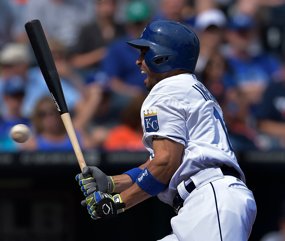 . Kansas City Royals second baseman Omar Infante (14) is hit by a pitch during the second inning of their baseball game against the Detroit Tigers, Saturday, Sept. 20, 2014, in Kansas City, Mo. (AP Photo/Reed Hoffmann)