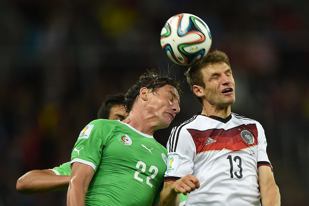 . Algeria\'s midfielder Mehdi Mostefa (L) and Germany\'s forward Thomas Mueller vie for the ball during a Round of 16 football match between Germany and Algeria at Beira-Rio Stadium in Porto Alegre during the 2014 FIFA World Cup on June 30, 2014.   KIRILL KUDRYAVTSEV/AFP/Getty Images